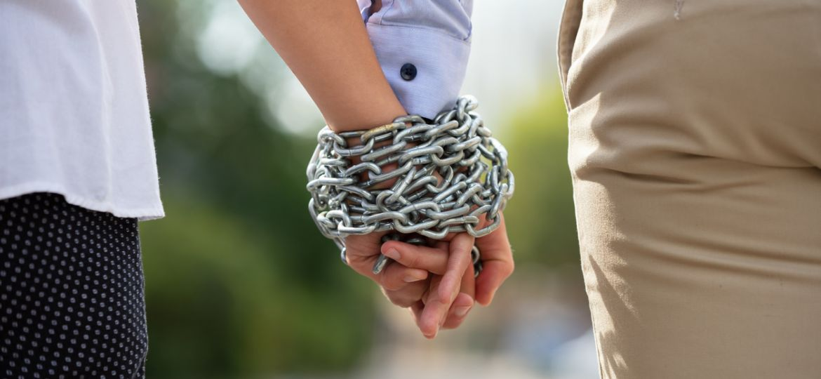 Couple's Hand Tied With Metal Chain